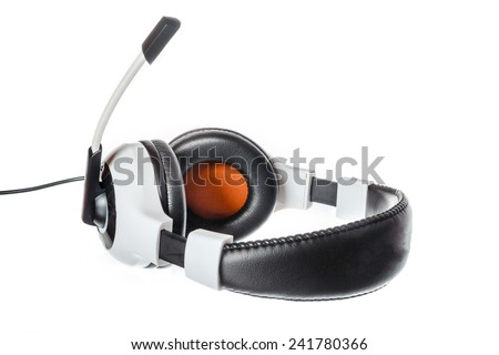 Black and white pc or computer headphones with microphone side view isolated on white. Voip and agency or company internet calls photo compsition