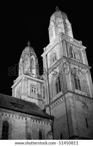 Black and white photo of a Grossmunster Cathedral at night (Zurich, Switzerland) - stock photo