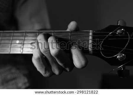 Black and White Photo of A Guy Playing Guitar in key C Major