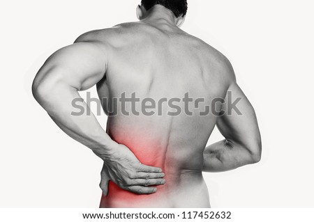 Black and white photo of a muscular man with a backache. Red selective color further illustrates pain. Clipping path included so image can be easily transferred to a different colored background. - stock photo