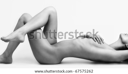Black and white photo of a naked beautiful woman - stock photo