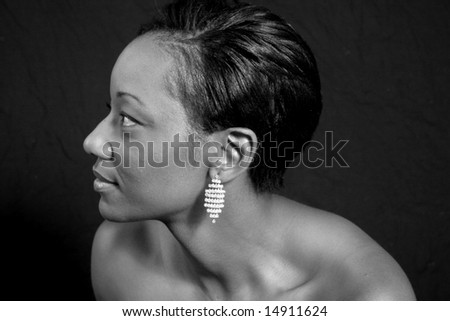 Black and white photo of an African american woman looking to the left - stock photo