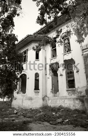 Black and white photo of an old, abandoned, ruined house with beautiful details  - stock photo