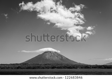 Black and white photo of approach to volcano Conception on Ometepe Island, Nicaragua from the sea. - stock photo