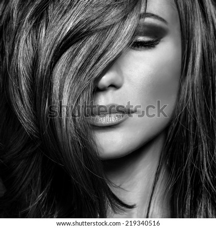 Black and white photo of attractive supermodel with sexy stylish makeup and healthy shiny hair, seductive female on luxury photo shoot - stock photo