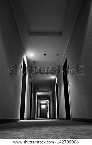 Black and white photo of dark corridor - stock photo