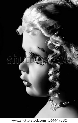 Black and white photo of,doll profile. - stock photo