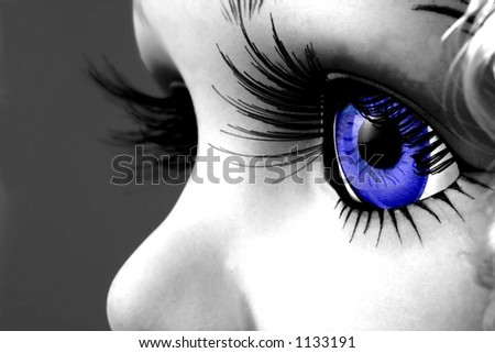 Black and white photo of doll with blue eye. - stock photo