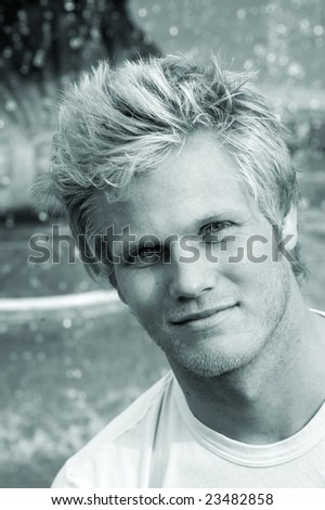 Black and white photo of good looking blond surfer guy. - stock photo