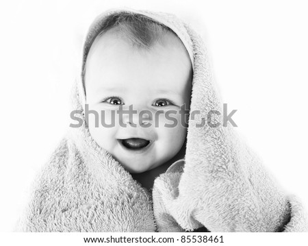 black and white photo of  Happy baby with towel - stock photo