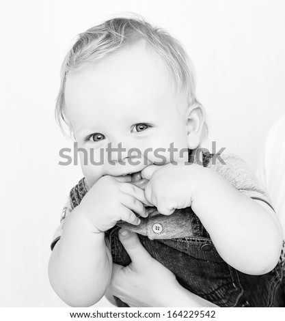 Black and white photo of laughing baby boy  - stock photo