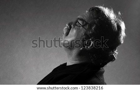 black and white photo of man resting his eyes closed - stock photo