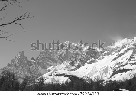 Black and white photo of Monte Bianco mountains in Winter ( Courmayer Aosta Valley ) - stock photo