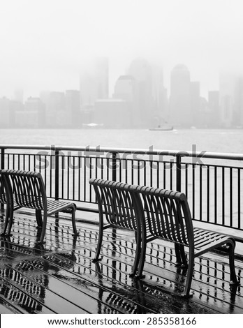 Black and white photo of New York City skyline on a rainy day  - stock photo