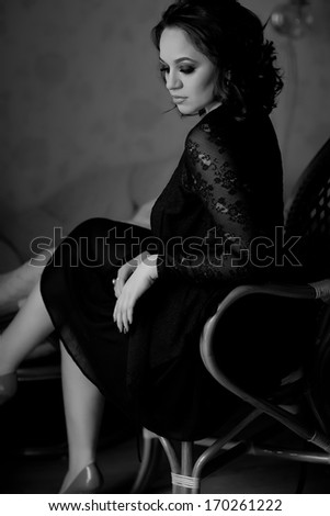 Black and white photo of sensual woman - stock photo