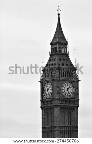 "Black and white photo of the famous and iconic British clock tower ""Big Ben"" in London, England. - stock photo"