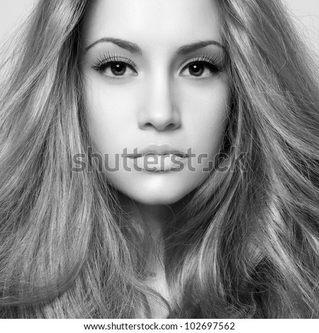 Black and white photo of young beautiful woman - stock photo