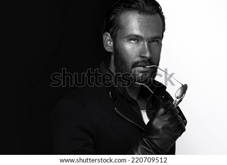 Black and white photo of young handsome man  - stock photo