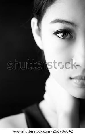 Black and white photo portrait of woman looks at the camera - stock photo