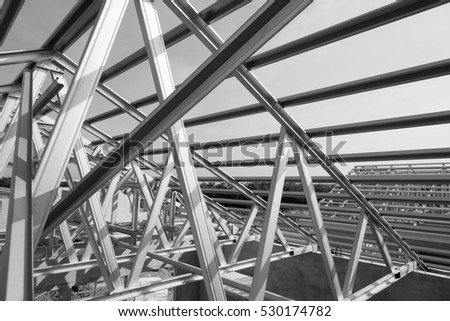 Black And White PhotoStructure Of Steel Roof Frame For Building Construction