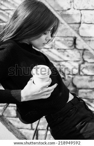 black and white photograph of a beautiful young sad girl - stock photo
