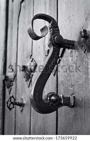 black and white photograph of an old door knocker