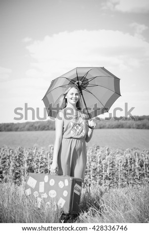 Black and white photography of beautiful amazed young lady, field background copyspace