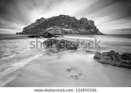 Black and White photography with long exposure of the Coastline in Aguilas, Spain - stock photo