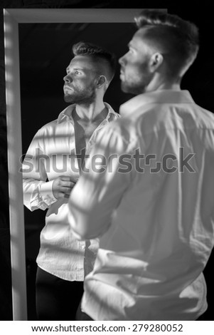 Black and white picture of attractive male model - stock photo