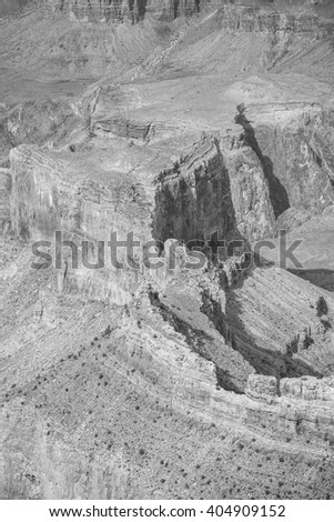 Black and white picture of rock formations in the Grand Canyon National Park, one of the top tourist destinations in the United States.