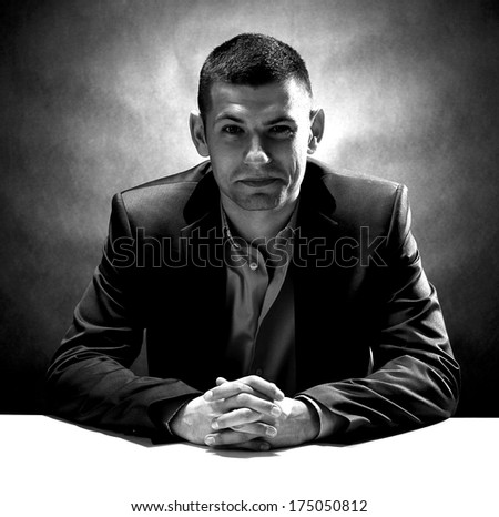 Black and white picture of smiling crook - stock photo
