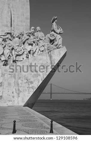 black and white picture of the famous monument to the maritime discoveries in Lisbon, Portugal (April 25th bridge on the background) - stock photo