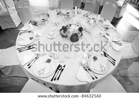 black and white picture of wedding table setting - stock photo