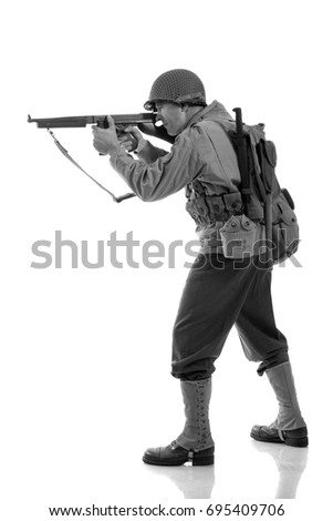 Black and white portrait  Male actor in military uniform of an American Marine of the Second World War period posing against a white background