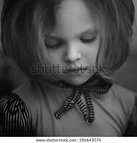 black and white portrait, melancholy little girl - stock photo