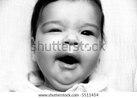 black and white portrait of a beautiful baby - stock photo