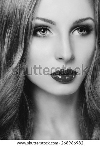 Black and white portrait of a beautiful fashion model face - stock photo