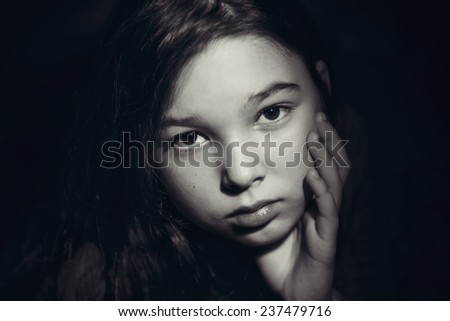 Black and white portrait of a little girl - stock photo
