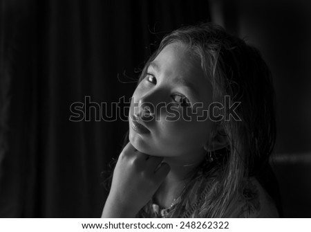 Black and white portrait of a pensive girl - stock photo