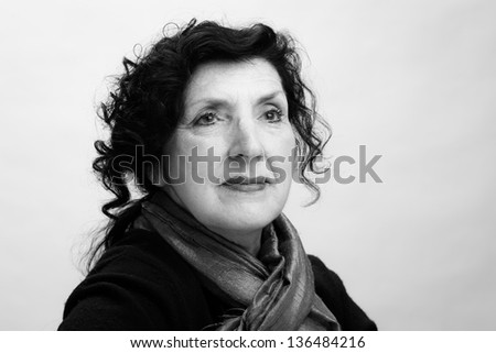 Black and White Portrait of a Pretty Older Woman Looking away from the Camera