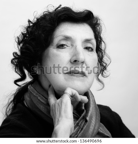 Black and White Portrait of a Pretty Older Woman Looking Directly to the Camera
