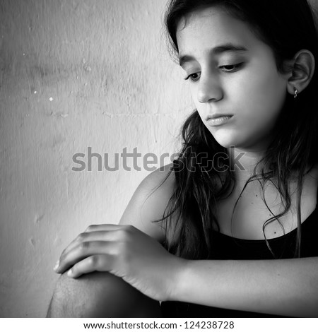 Black and white portrait of a sad and lonely girl