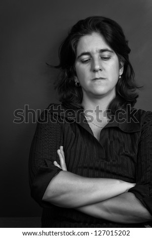 Black and white portrait of a sad and lonely hispanic woman
