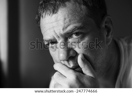 Black and white portrait of a sad man - stock photo