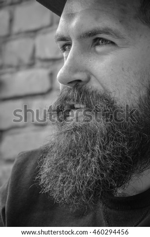 Black and white portrait of a serious man, side view