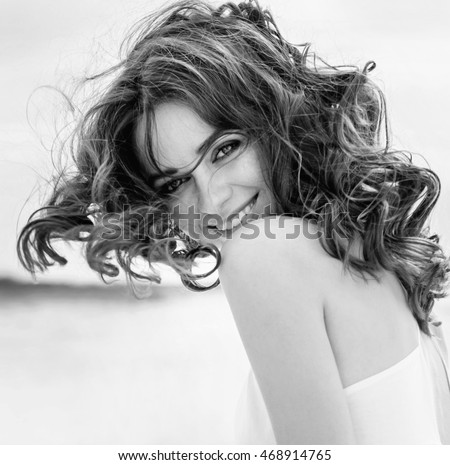 Black and white portrait of a young beautiful woman woman in black white