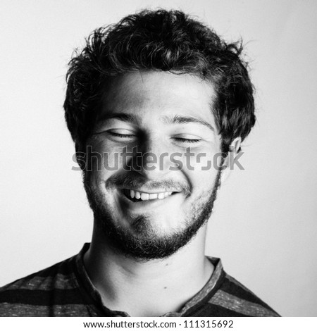 Black and White Portrait of a Young College boy wth his eyes shut