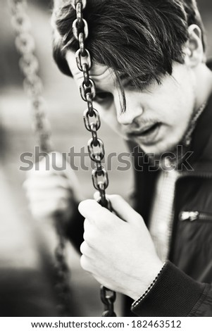 Black and white portrait of a  young man  closeup  - stock photo