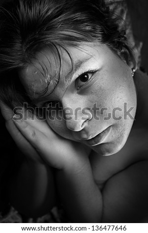 Black and white portrait of an praying girl. - stock photo