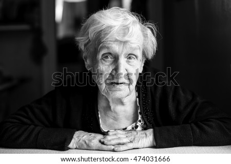 Black and white portrait of an senior woman, close-up.